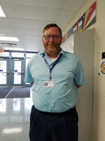History teacher Phillip Strickland loves classic rock–and teaching