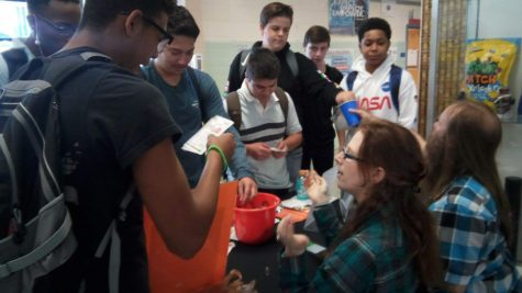 Students gathered around a booth hosted by Virginia Beach Public Library, playing games to receive candy.