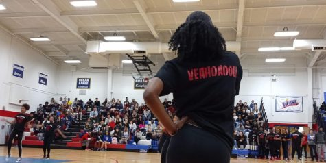 A member of the Big Chiefs dance team takes a dance break to cheer on teammates during a 2019 pep rally.