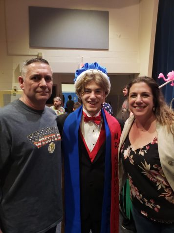 Liam Besserer, Mr. Kempsville 2019, with his parents after the pageant.