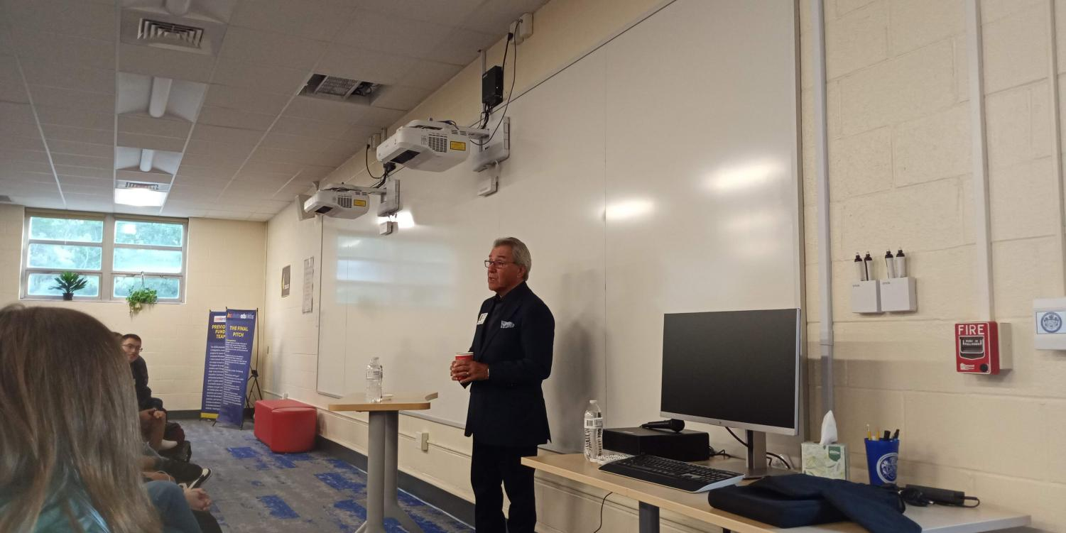 Michael Coles, who was a co-founder of the Great American Cookie Company and former CEO of Caribou Coffee, speaks in the EBA seminar space during the first block on Wednesday, September 18. He spoke to a crowd of mostly EBA students, as well as DE Public Speaking and Leadership Skills classes.