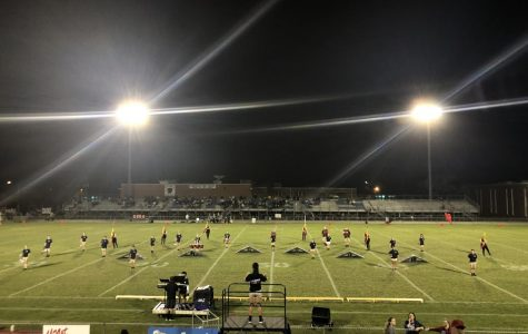 "KHS Marching Band Performs ""Balance"" at Varsity Football Games"
