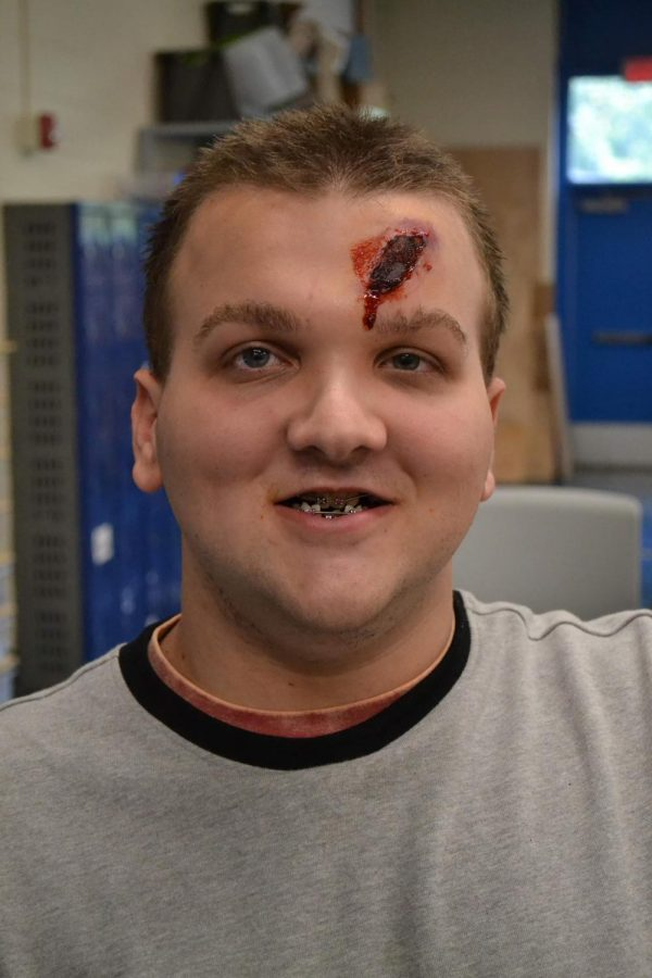 Dylan+Cominskie%2C+freshman%2C+displaying+moulage+applied+by+Ms.+Elizabeth+Jones++during+her+meeting+to+teach+TSA+students+on+moulage+application.+