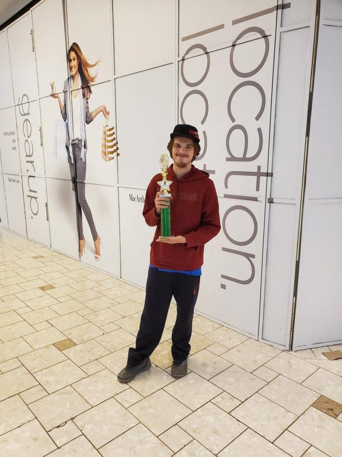 Preston+Lewis%2C+Chess+Club+member%2C+with+his+trophy+from+his+win+at+the+tournament+at+MacArthur+Mall+last+year.+