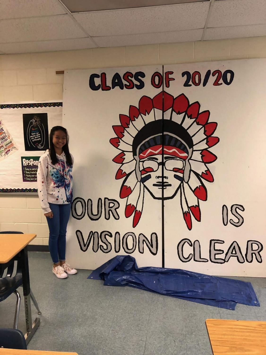 Katherine Louise Guevara in front of the senior sign that she designed.