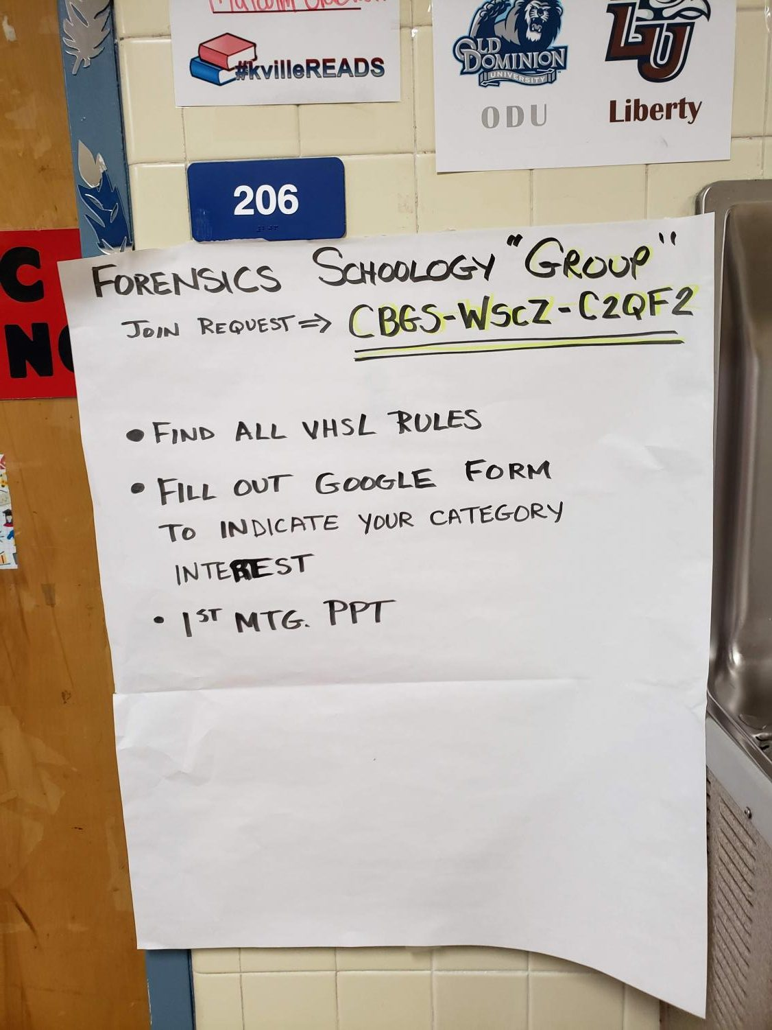 Poster hanging outside Ms. Boubouheropoulos' door with all of the Schoology group information. Students who are interested in joining the club, or members who want more information about competitions can find that through joining the group on Schoology.