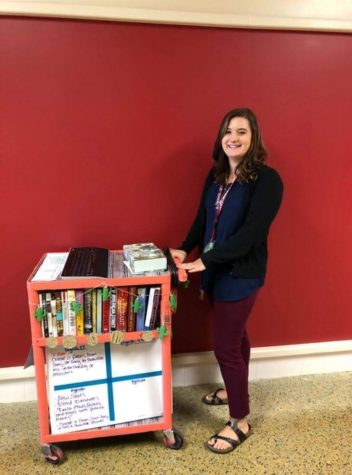 Ms. Taylor Guckert with her classroom in a cart.  She doesn't have an assigned classroom because she is a