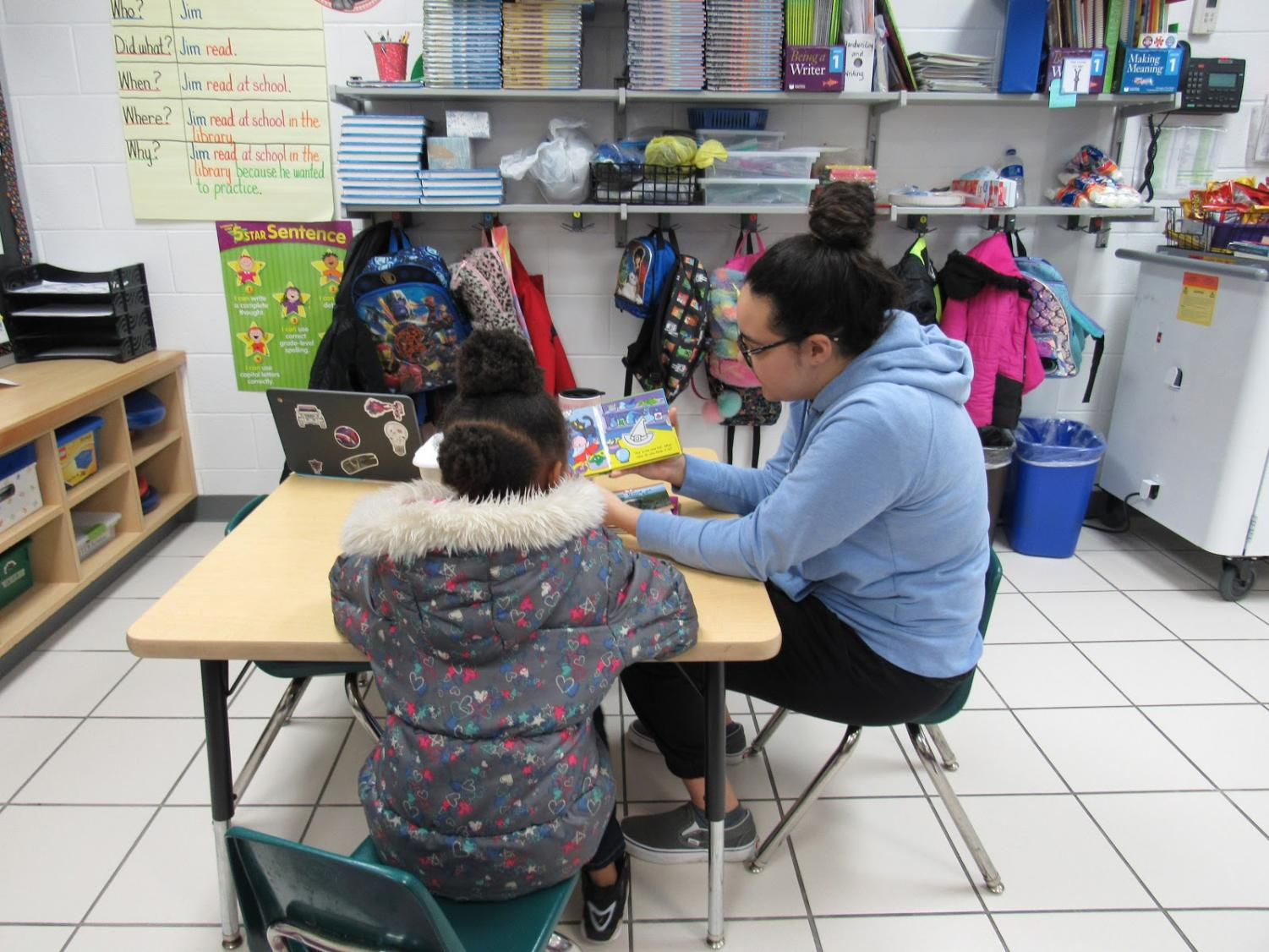 A member of the Interact Club reads with a young student at Diamond Spring Elementary School on January 25.