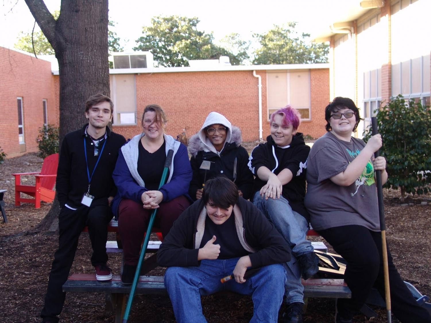GSA students posing with their tulip planting supplies after they finished planting.