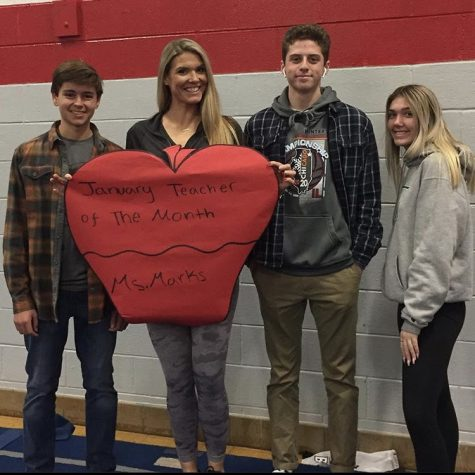 Ms. Marks pictured with members of the SCA for January's Teacher of the Month.