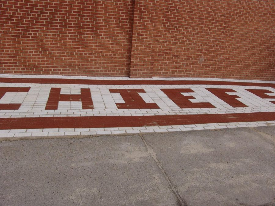 The final project spells 'CHIEFS' in red bricks.