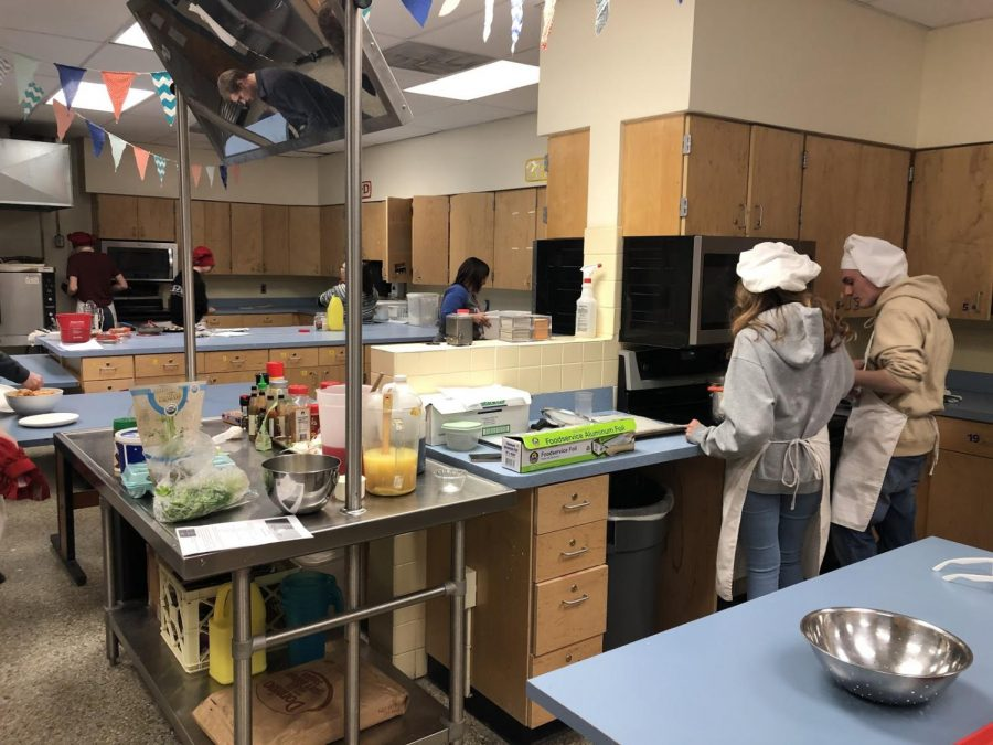 Students in catering making homemade Gnocchi with different sauces and toppings.